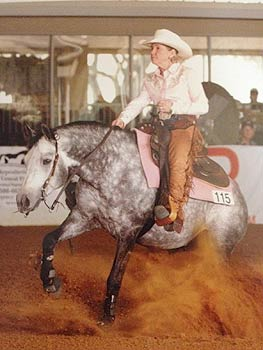 A rider performs at a western style horse show.