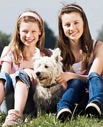 A dog and two girls