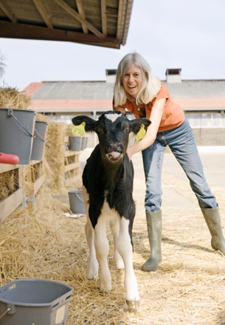 A woman vet and calf