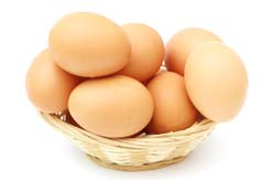 Freshly collected eggs in a small basket