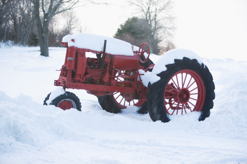 A tractor in the snow